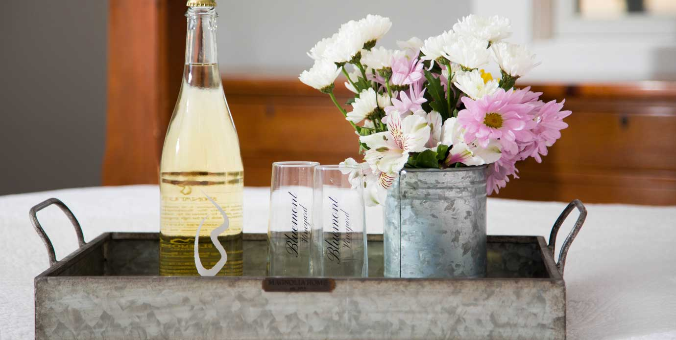 Henway Hard Cider and flowers on rustic metal tray
