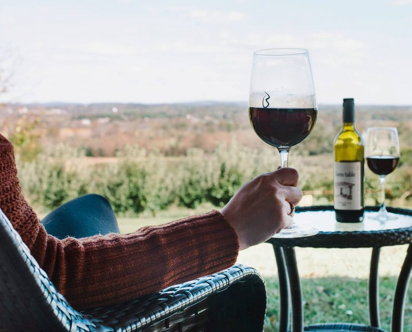 Private Patio with person holdingglass of red wine